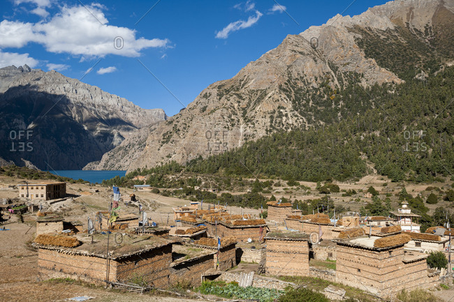 Looking down on the old Tibetan settlement of Ringmo and the turquoise blue Phoksundo lake in the Dolpa region of Nepal