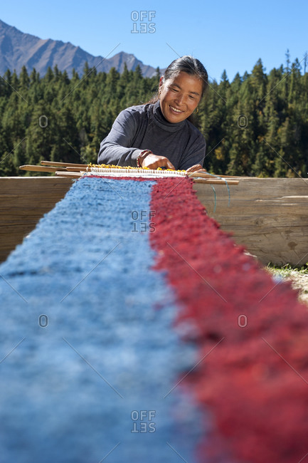 A Tibetan woman weaves using a handloom at Ringmo in the remote Dolpa region of Nepal