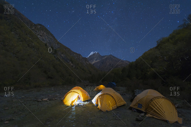 Tents glow under starry skies in the little explored Kagmara valley in the remote Dolpa region of Nepal