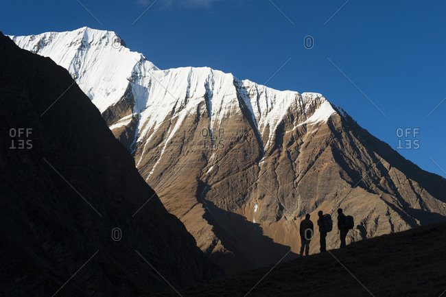 Trekkers admire the superlative views of Lhashama in the in the Kagmara valley in lower Dolpa a remote region in northwest Nepa