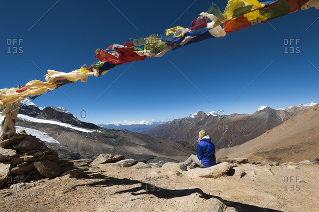 Trekkers looking out from the top of the Kagmara La in Dolpa, a remote region of Nepal