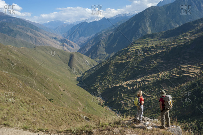 A couple stops to admire the view in Juphal valley while trekking in Dolpa, a remote region of Nepal
