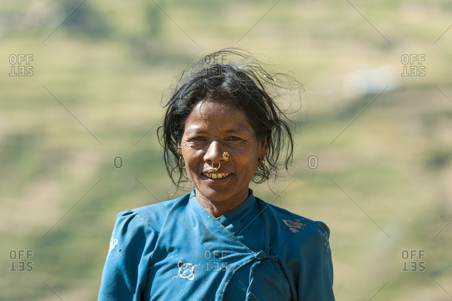 A woman in the Juphal valley harvests grass for the animals. Dolpa, Nepal