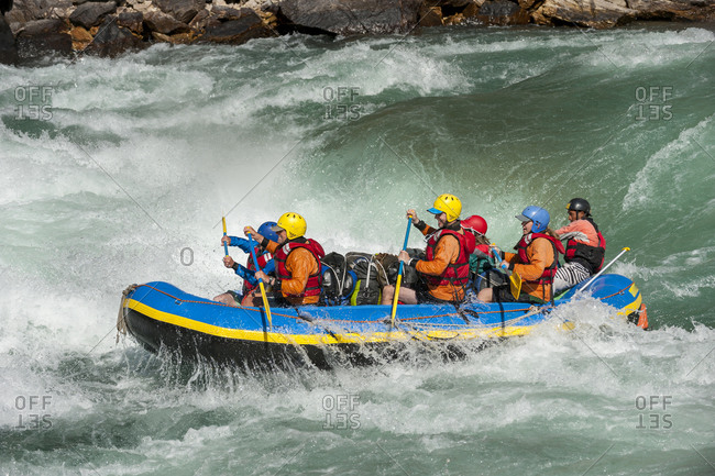 Rafters get splashed as they go through some big rapids on the Karnali river in Nepal