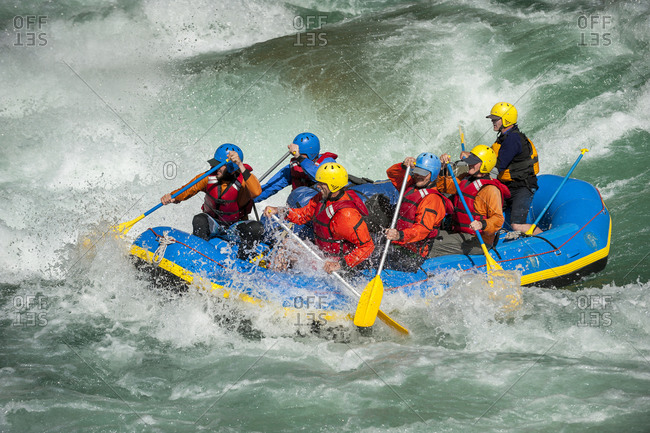 A raft goes through a big rapid on the Karnali river in west Nepal