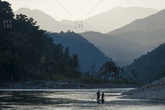 A traditional dugout canoe made from a hollowed out tree on the Karnali river in Nepal