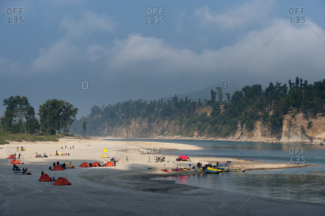 Large campsite along the Karnali river during a rafting and kayaking expedition