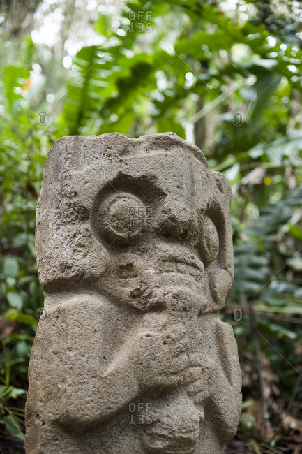 An ancient pre-Columbia stone carving in the jungle at San Agustin in the south of Colombia