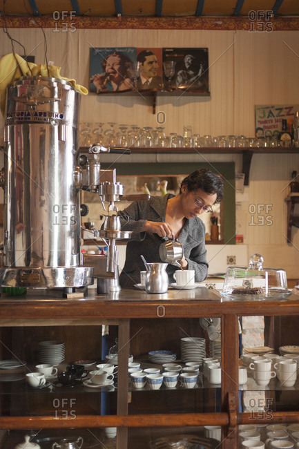 A woman working in a traditional coffee shop in Salento, a coffee producing region of Colombia