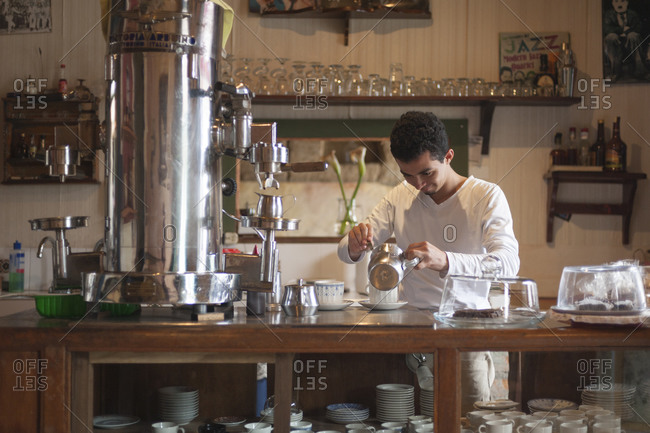 A man working in a traditional coffee shop in Salento, a coffee producing region of Colombia.