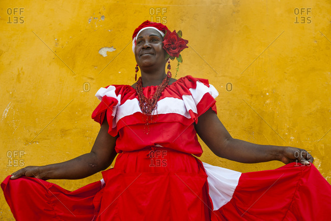 Cartagena, Caribbean Coast Region, Colombia - February 9, 2013: Woman dressed in traditional clothes in the colorful old town of Cartagena