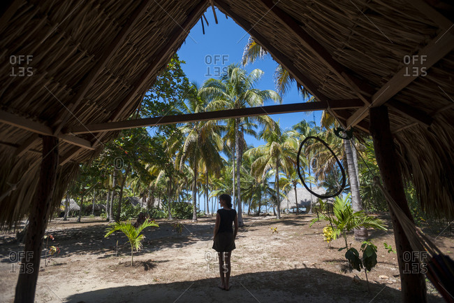 Standing in the entrance of a beach hut in Palomino on the Caribbean coast of Colombia
