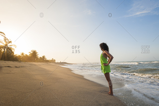 A girl plays in the waves at Palomino on the Caribbean coast of Colombia