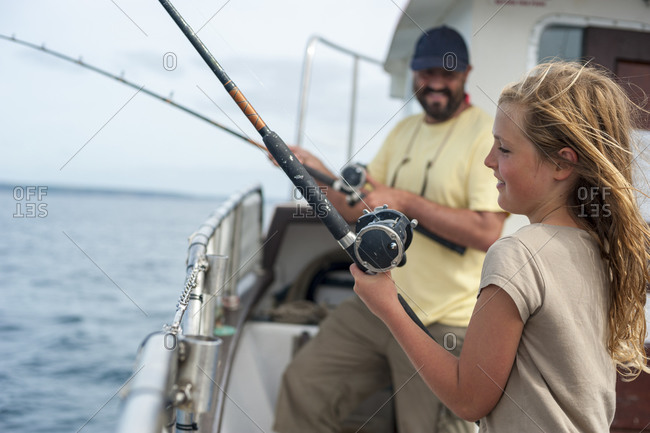A girl and her father on a fishing trip from Penzance in Cornwall