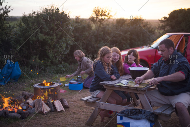 Penzance, Cornwall, England - September 2, 2013: A family prepares mackerel for the barbecue at a campsite in Cornwall