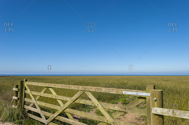 Five-bar gate and distant views of the sea on the north coast of Cornwall in the United Kingdom