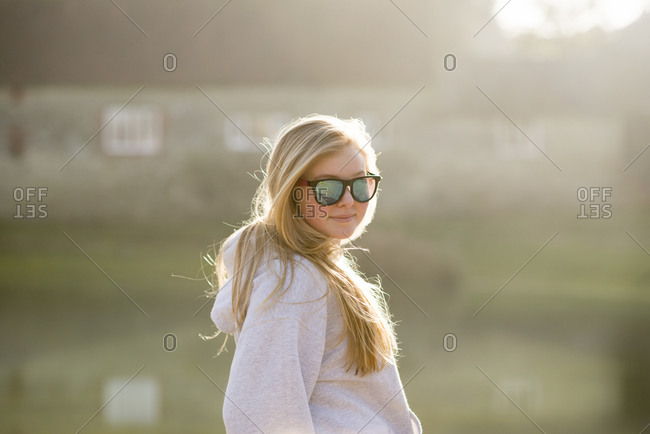 A young girl poses for the camera on a sunny day