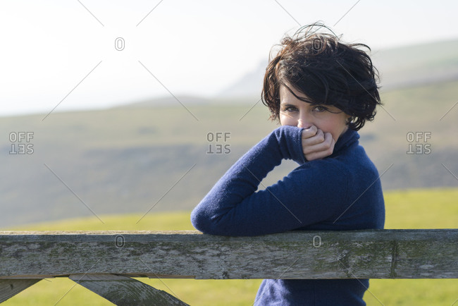 A girl poses for the camera on a perfect sunny day in Dorset on the south coast of England