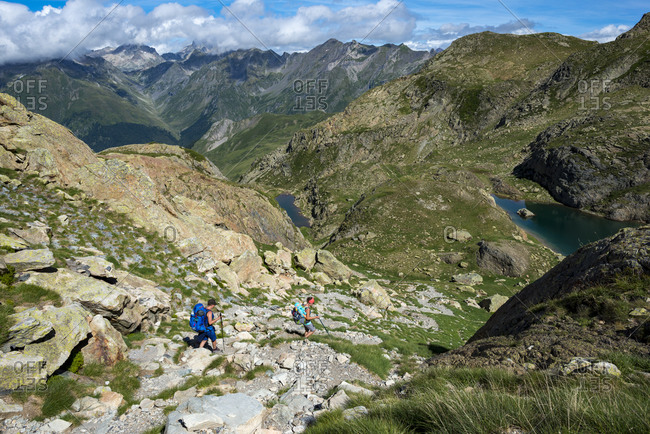 Walkers descend from the top of Col Peyreget while hiking the GR10 trekking trail