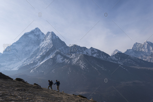 Trekkers climb a small peak above Dingboche in the Everest region of Nepal in time to see the sunrise. Ama Dablam is the mountain in the distance.