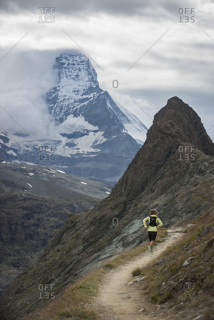 Running on the trail beside the Gorner Glacier with views of the Matterhorn in the distance