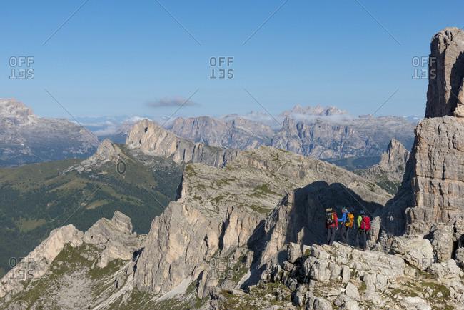 Two walkers hiking through typical mountainous terrain of the Dolomites range of the Alps on the Alta Via 1 trekking route near Rifugio Nuvolau