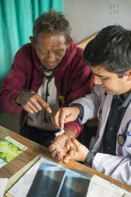 A doctor examines a patient in a rural hospital in Nepal