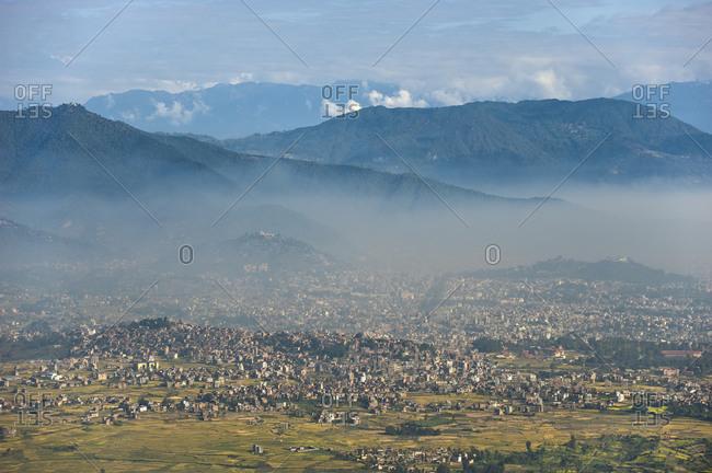 Kathmandu, Kathmandu Valley, Nepal - October 25, 2008: The sprawling concrete metropolis under a cloud of pollution seen from the top of Hatiban