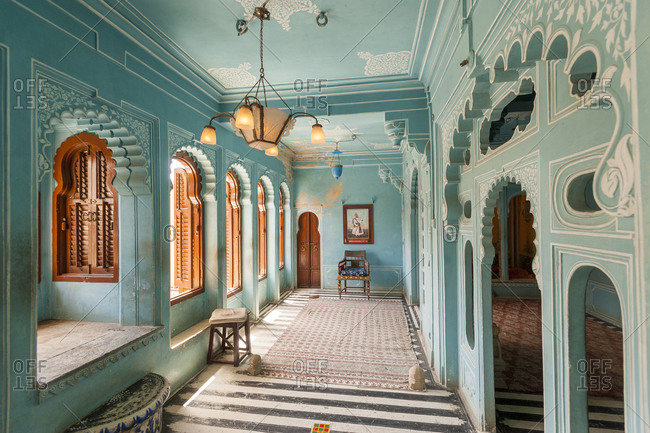 Udaipur Palace, Udaipur, Rajasthan, India - September 3, 2012: Beautiful turquoise room within Udaipur Palace in Rajasthan in India