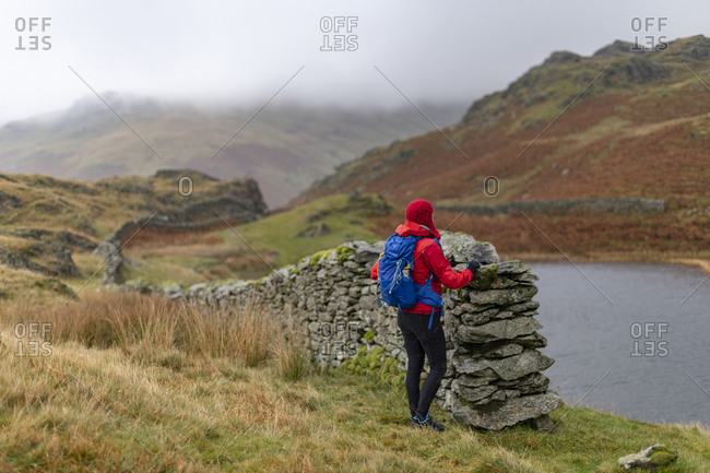 Alcock Tarn by a dry stone wall in The Lake District
