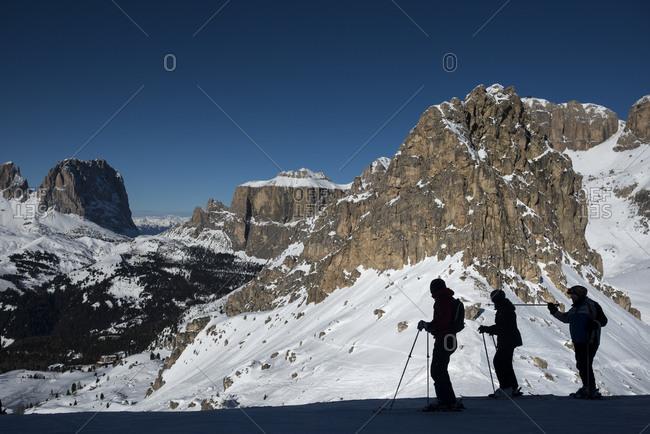 Trentino, Dolomites, Italy - January 13, 2014: Skiers in the Italian Dolomites prepares to make their way around the Sellaronda