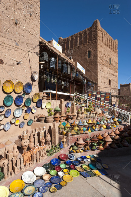 Colorful Tajine pots and plates for sale in a Kasbah in Ouazarzate