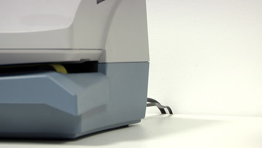 Franking machine producing a stack of freshly postaged letter.