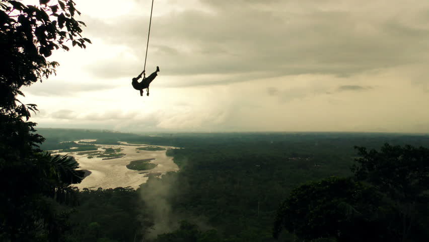 Silhouette Of An Adult Man On A Swing Over The Horizon Slow Motion #10012244