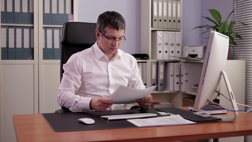 Financial Officer prepares a report/Financial Officer at Work   Shutterstock HD Video #10013300