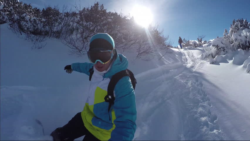 Snowboarders riding fresh snow on the sunny mountain | Shutterstock HD Video #10044032