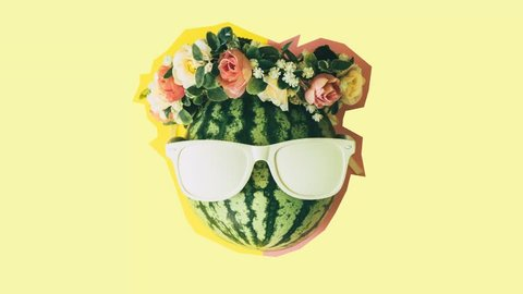 head of watermelon in white sunglasses and a floral wreath. minimal