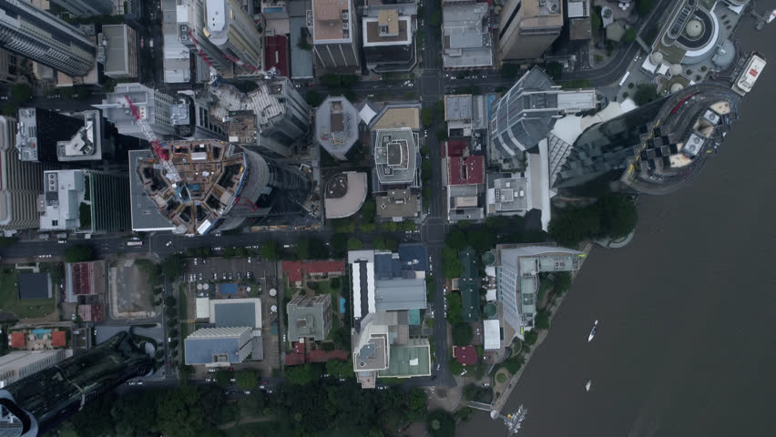 Aerial Shot of Brisbane City Late afternoon 4k source River City 1 of 21 in a set Cloudy & Blue Sky God point of View Eye, Looking down on buildings | Shutterstock HD Video #1006572646