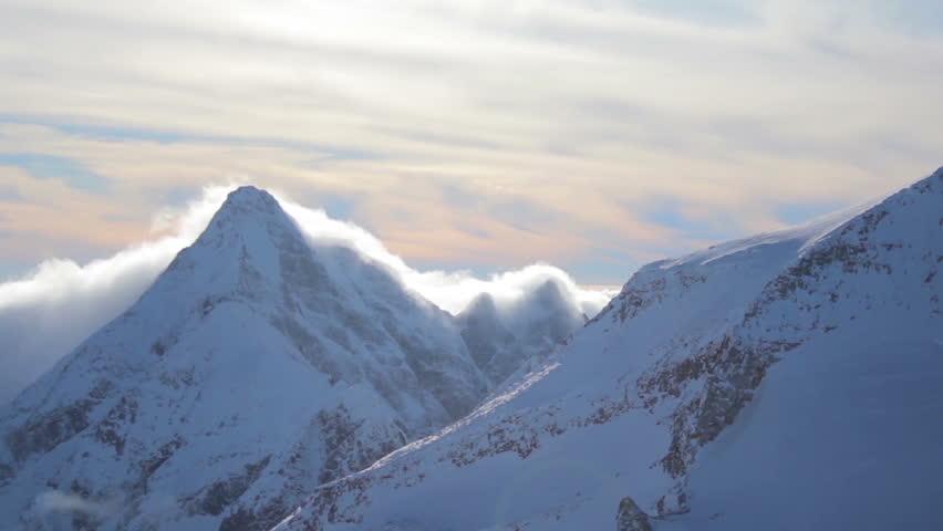 Time lapse of a mountain peak in winter   Shutterstock HD Video #10065971
