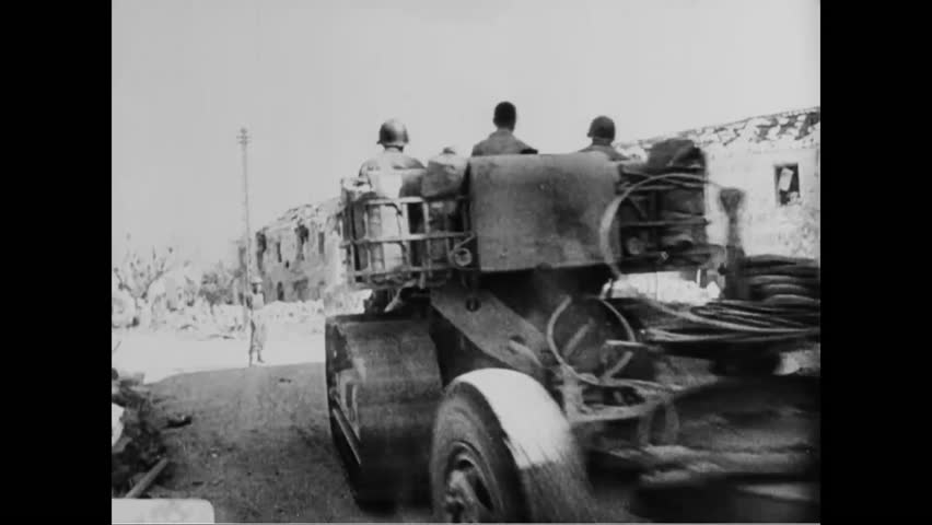 CIRCA - 1944 - Combat in Italy, France and in the Pacific is shown and prisoners of war are taken during World War 2.