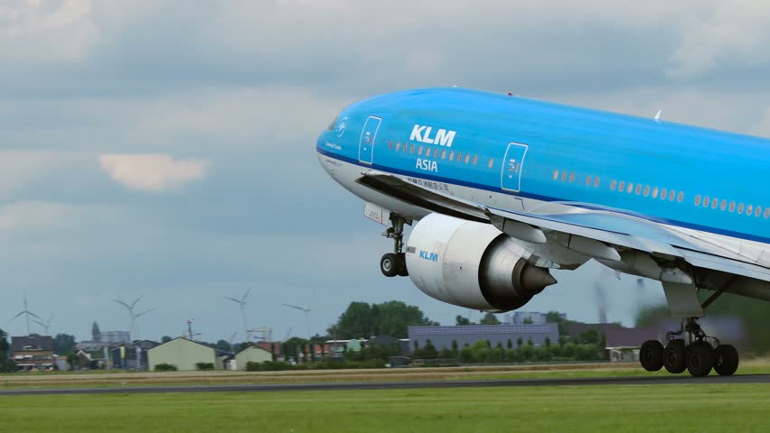 AMSTERDAM, NETHERLANDS - JULY 26, 2017: Boeing 777 PH-BQL of KLM Asia airlines is gaining altitude right after it detached from the ground