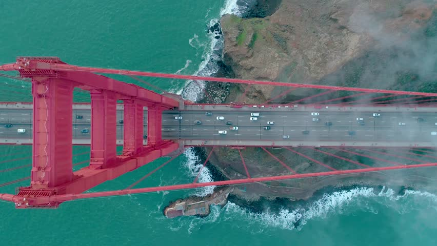Golden Gate Bridge. Aerial of the Golden Gate Bridge in San Francisco in a misty day. View from top to bottom. Aerial. Drone. California, USA. 4k