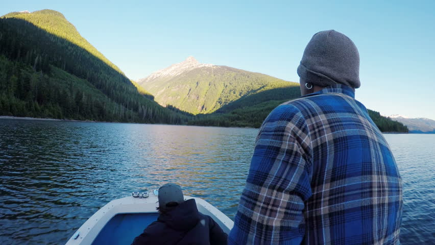 Rear view of man riding a boat in the river 4k | Shutterstock HD Video #1006628419