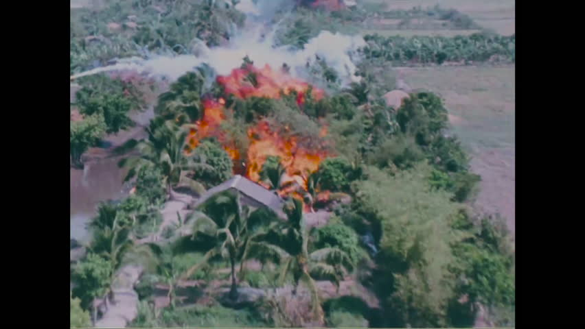 CIRCA 2010s - Napalm is dropped on villages during the Vietnam War causing massive fireballs and destruction.