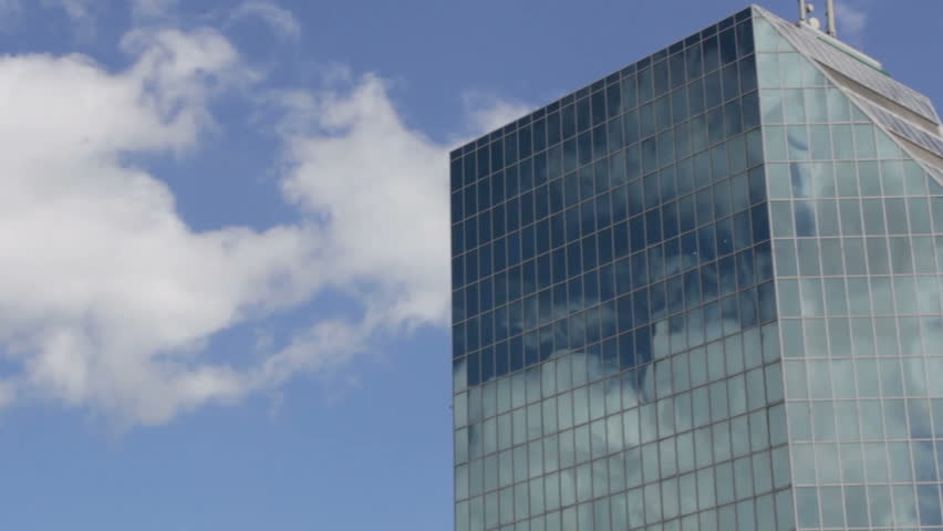 Modern business building  with clouds reflection  | Shutterstock HD Video #1006684906