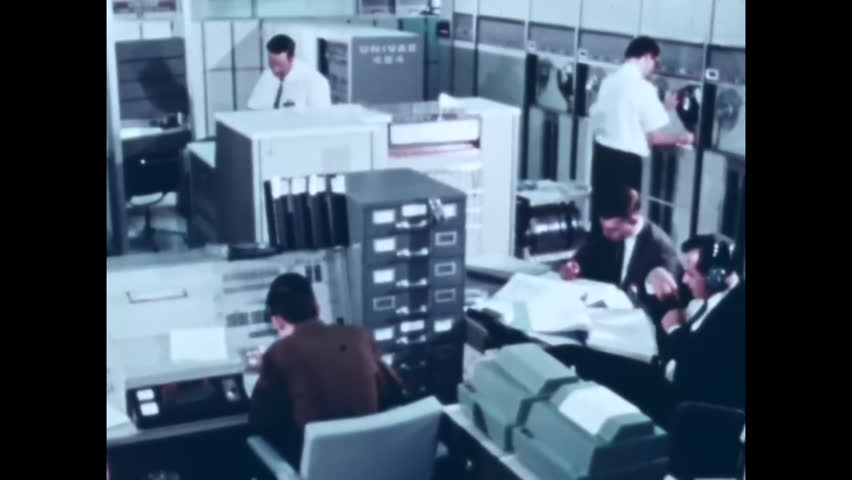CIRCA 1967 - Communications control rooms are shown working in real time with an Apollo flight. | Shutterstock HD Video #1006690990