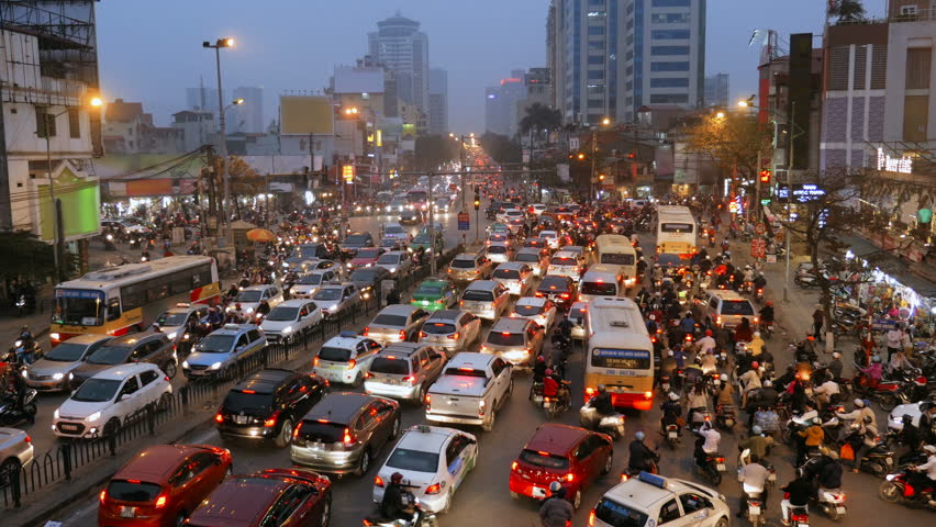 A crowded mess of motorbikes, cars and buses during rush hour at an intersection in Hanoi, Vietnam, Southeast Asia | Shutterstock HD Video #1006691413