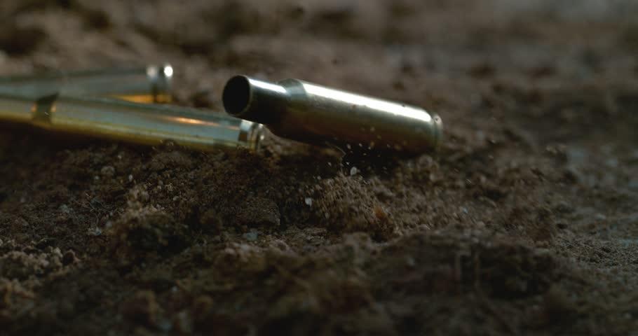 Bullet casings falling to the floor in slow motion shot on Phantom Flex 4K at 1000fps