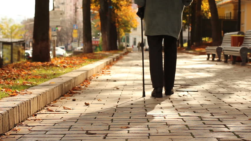 Lonely, old, person walking down street with stick, limping. Gait, legs disease Royalty-Free Stock Footage #1006708051