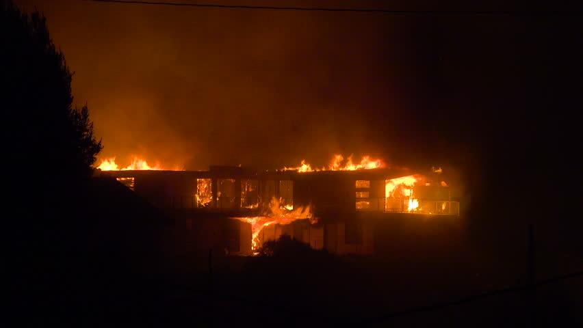VENTURA, CALIFORNIA - CIRCA 2010s - A large home burns at night during the 2017 Thomas fire in Ventura County, California.